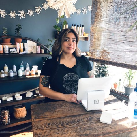 Botanica Beauty Parlour owner Jennifer Zamora welcomes clients at the front desk of her new establishment on Main Street in downtown Whitewater.