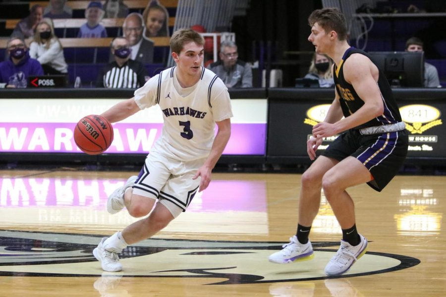 University of Wisconsin-Whitewater men's basketball sophomore guard Gage Malensek (3) drives the ball against UW- Stevens Point freshman guard Ryan Genrich (4), during a game between the Warhawks and Pointers on Wednesday Feb. 3.