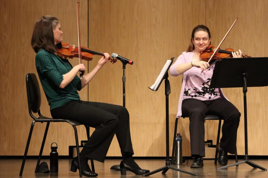Amber Dolphin (left) and Carol Carlson both played the violin during Pecatonica String Quartet's performance inside Young Auditorium.
