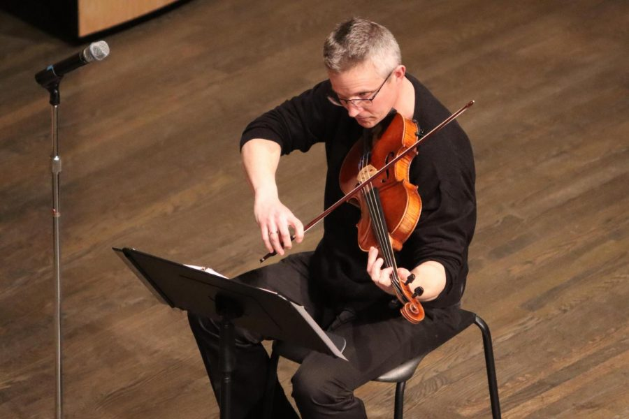 Pecatonica String Quartet musician Christopher Dozoryst plays the viola during the group's performance inside Young Auditorium.