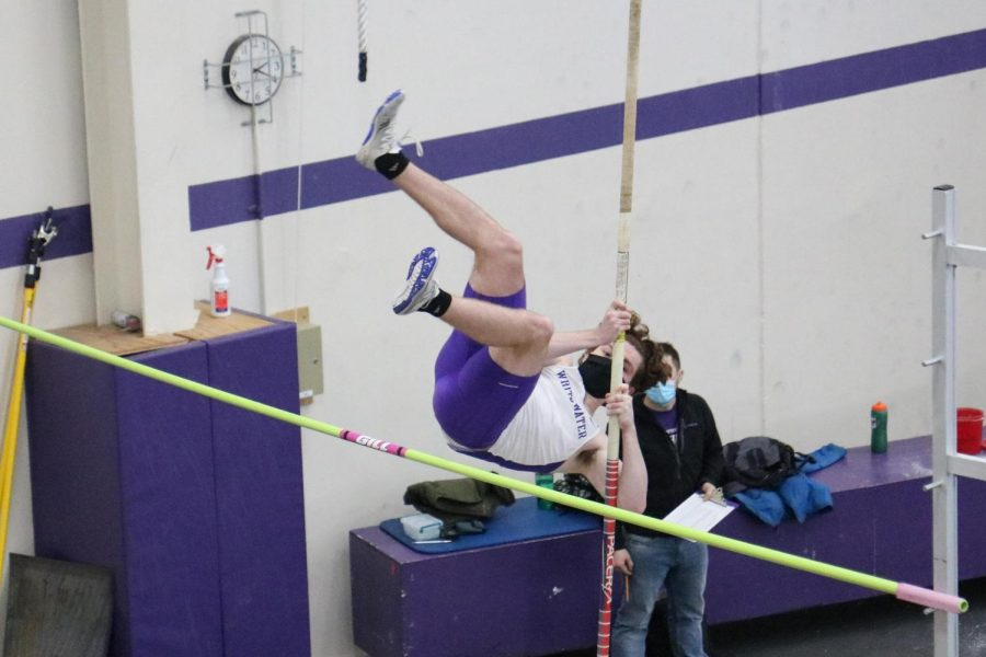 Freshman Jack Mcginn competes in the pole vault during the Warhawks track & field meet against UW-Oshkosh.