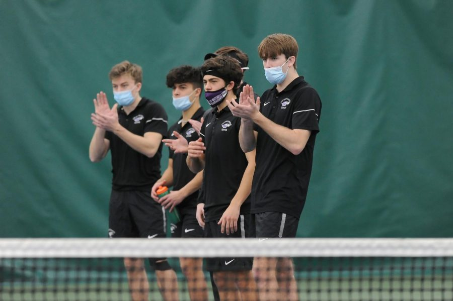 Members of the UW-Whitewater men's tennis team encourage their teammates during a match against Luther (Iowa) Saturday, Feb. 13.