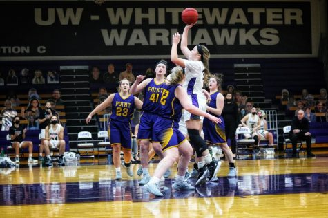 Sophomore forward Aleah Grundahl (33) jumps up to go for a basket during UW-Whitewater's game against UW-Stevens Point. Grundahl (33) finished the game with a team high 16 points.