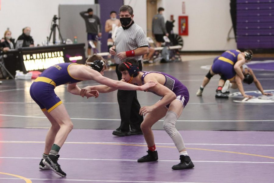 UW-Whitewater freshman wrestler John Fortugno (right) competes during a match against UW-Stevens Point Friday Feb. 5.