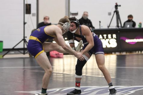 UW-Whitewater freshman wrestler Isaiah Mohmed (right) competes during a match against UW-Stevens Point Friday Feb. 5.