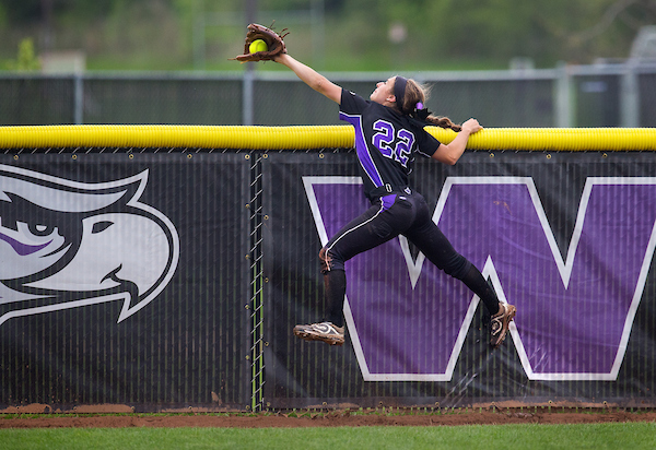 UW-Whitewater outfielder Caitlin Catino goes skyward to make a spectacular catch before the ball can go over the outfield fence during a regional championship game on Monday, May 14, 2018 against Coe (Iowa). The Warhawks won the game 3-2 to advance to the Super Regional.