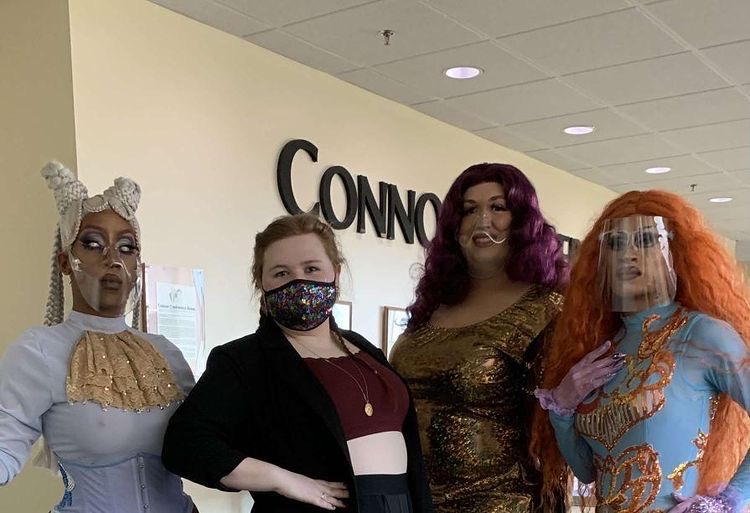 From left to right: Malaiya Marvel, Alyx Koon, Victorya Attwood and Melee stand for a photo during the production of the 12th annual IMPACT drag show, which aired on UWWTV March 25.