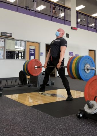 Daniel Jones, head of the powerlifting division, deadlifts a heavy weight.