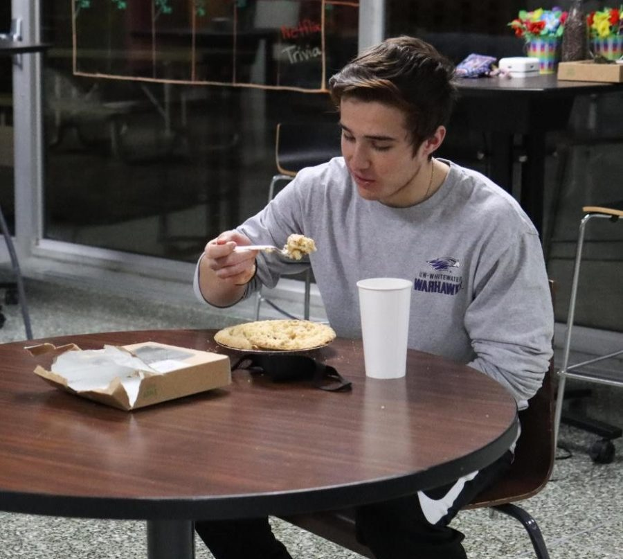 Michael Maher prepares to take a bite of pie while competing against sophomore Lauren Stein in the pie eating competition held at Jitters Coffee Lounge.