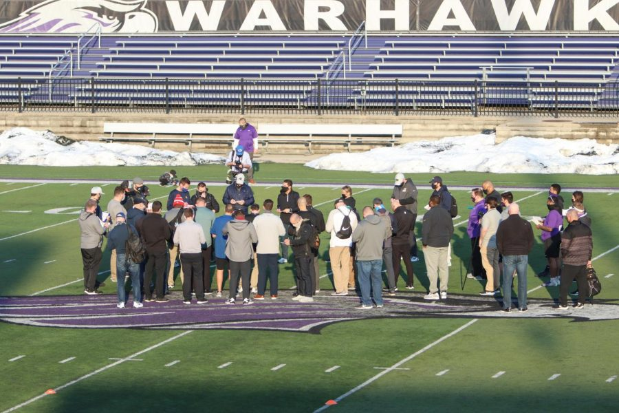Representatives from NFL teams and other football related positions gather at mid-field during the outdoor portion of UW-Whitewater Pro Day.