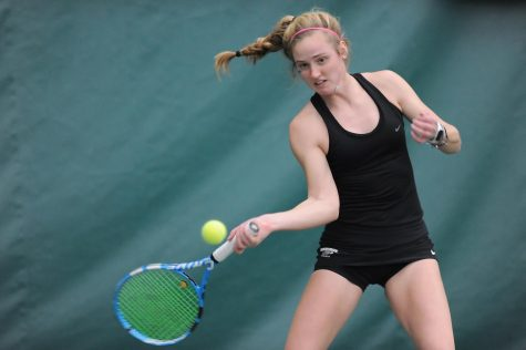 Junior Madalyn Bigelow prepares to hit the ball during the Warhawks match against Cardinal Stritch at Lake Geneva Tennis Saturday Feb, 13.