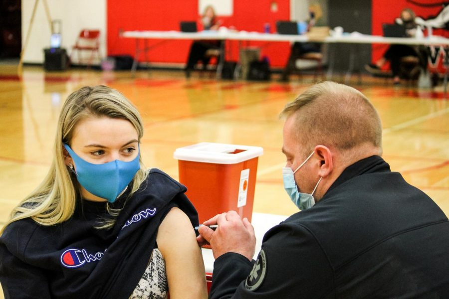 March 16th, the mobile COVID-19 vaccine clinic has been set up in the Whitewater High school gymnasium. Whitewater student Veronica Konzakova gets her first dose of the COVID-19 vaccine from Firefighter/EMT Joshua Green.