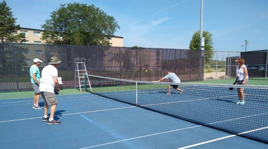 Organizational members stay active by playing pickleball out in the sunshine on a warm Wisconsin day.