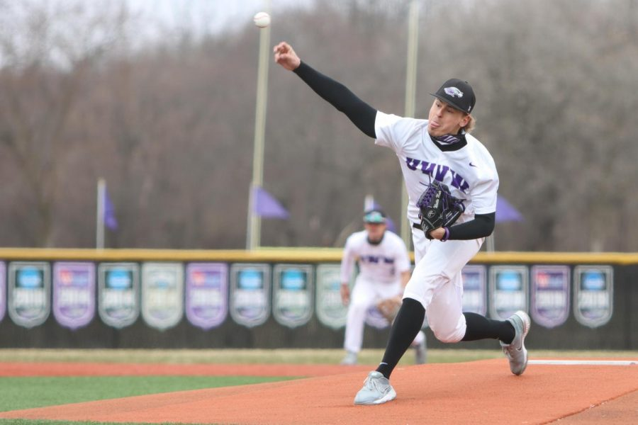 Junior Pitcher Westin Muir (18) leans forward to throw the ball towards home plate, during game one of the Warhawks doubleheader against UW-La Crosse Wednesday March 31.