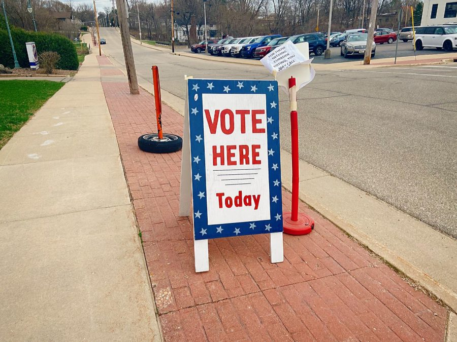Outside the Whitewater Armory Gym stands a sign telling Whitewater residents to vote, Tuesday, April 6th.