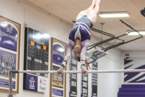 Sophomore Taiya Stelmachowski competes on Bars during the Warhawks dual meet vs UW-Oshkosh, inside Kachel Gymnasium Saturday April 3.