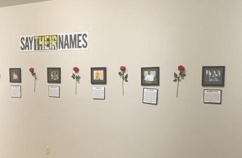 Wall of framed pictures in the Say Their Names exhibit