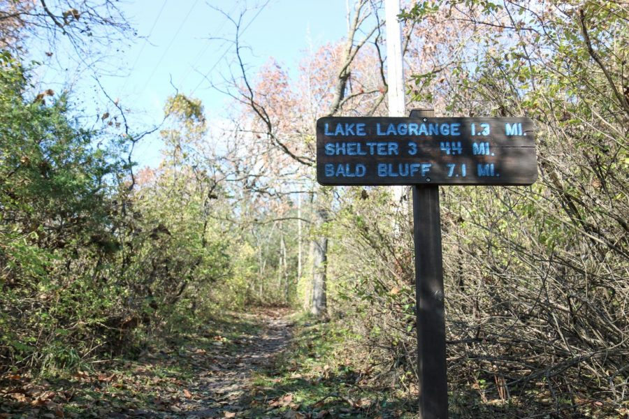 A distance marker sign located along the path of the south Kettle Moraine section of the Ice Age National Scenic Trail.