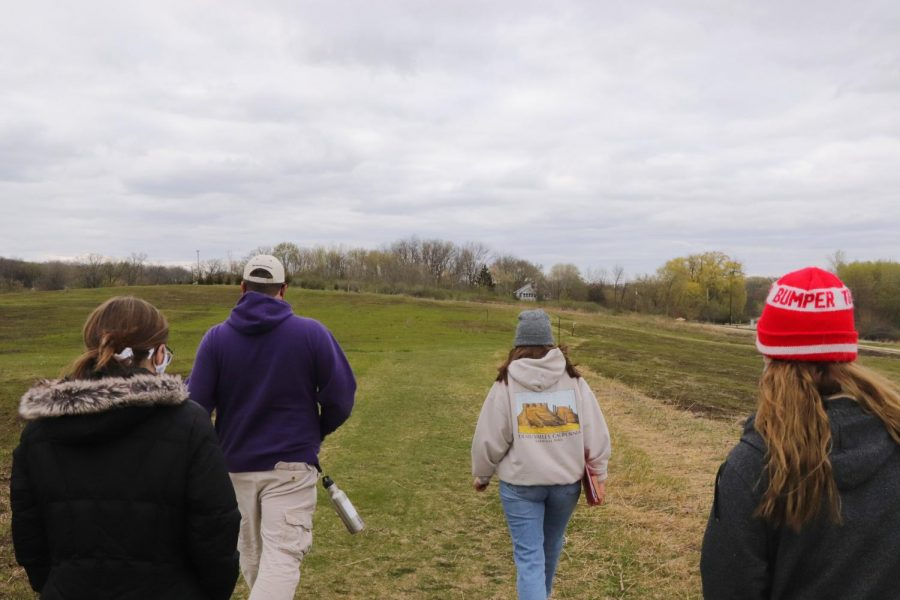 Director of Sustainability Wesley Enterline and Ashley Roscoe guide attendees through a Prairie Walk in the Whitewater Nature Preserve on campus, Thursday, April 15.
