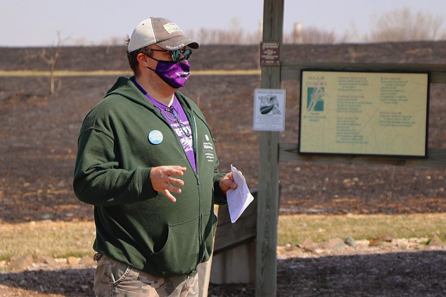 Sustainability Director Wesley Enterline guides attendees of the University of Wisconsin Whitewater Sustainabilty hosted event through the campus Nature Perseve in a mindful prairie walk, Saturday, April 3.