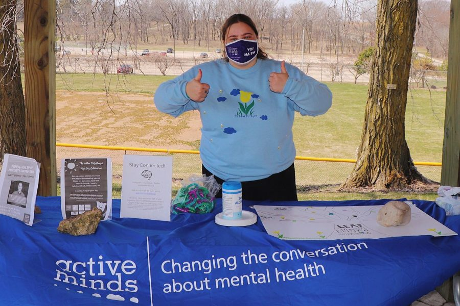 President Kelsey Pacetti of the Active Minds Organization staffs a table at the Sustainability hosted Event, Saturday, April 3.