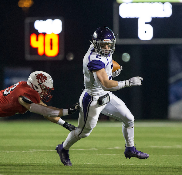 Warhawk running back Ronny Ponick evades a North Central defender. The UW-Whitewater football team makes its tenth appearance in the NCAA Division III national championship game, the Stagg Bowl, against North Central College (Illinois) at Woodforest Bank Stadium in Shenandoah, Texas, on Friday, Dec. 20, 2019. (UW-Whitewater photo/Craig Schreiner)