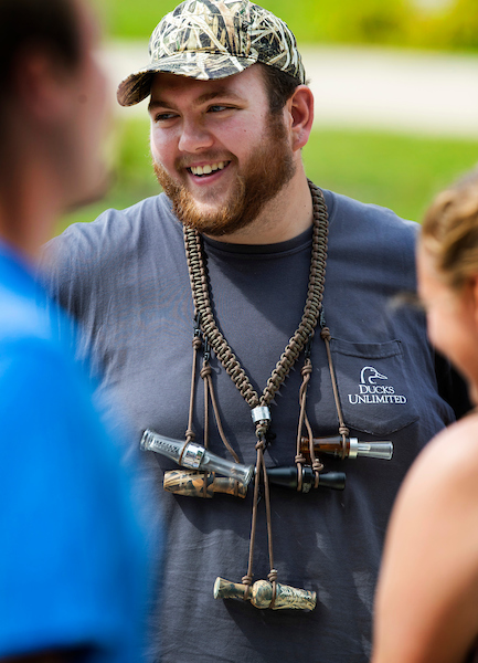 Accounting major Jacob Weis, wearing duck calls with different sounds for different conditions, staffs a table for the Ducks Unlimited student organization. Student organizations of all kinds are on display at Involvement Day on Wyman Mall on the UW-Whitewater campus on Wednesday, Sept. 11, 2019. (UW-Whitewater photo/Craig Schreiner)