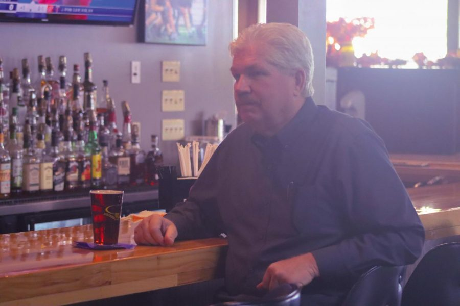 One of the owners and bartender of 841 Brewhouse Jim Burns sits beside an Oktoberfest beer.