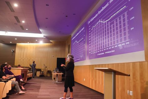 Senior student services specialist Jodi Ratcliff interprets as Provost John Chenoweth explains the projected number of enrolled students this year at the Academic Affairs Fall Forum Tuesday, Aug. 24.