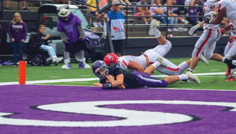 University of Wisconsin Whitewater Senior Quarterback Max Meylor (7) slams on the ground in the end zone as he scores during the game against Carthage in Perkins Stadium Sept. 4, 2021.