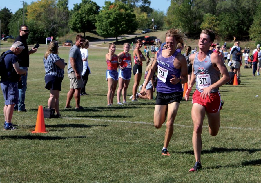 Whitewaters Freshman Chris Allen battles out a Washington U. competitor in the race to the finish line of the Tom Hoffman Invitational in Whitewater on Sept. 18, 2021.