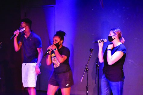 Dabe Okoli (Left), Maiya Tatum (Middle), and Peyton McLaughlin (Right) sing the song Super Bass for the other warhawks at karaoke night on 09/16/2021.