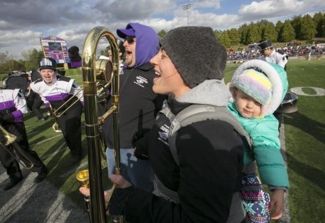 Alumni band members Geoff and Katie Poole (both 06) brought their daughter Samantha to the football game.