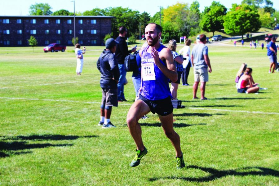 Senior Kyle Neuroth pushes toward the finish line of the Tom Hoffman Invitational meet in Whitewater, WI on Sept. 18th, 2021.