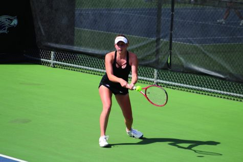 Freshman Cassie Lee looks to gain a point during her second round of the Intercollegiate Tennis Association Midwest Regionals held at the Warhawk Outdoor Tennis Complex on Saturday, Sept. 25, 2021.