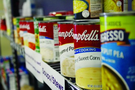 Different Campbell's cans line a shelf at the Warhawk Food Pantry in Drumlin Hall on Oct. 20, 2021.