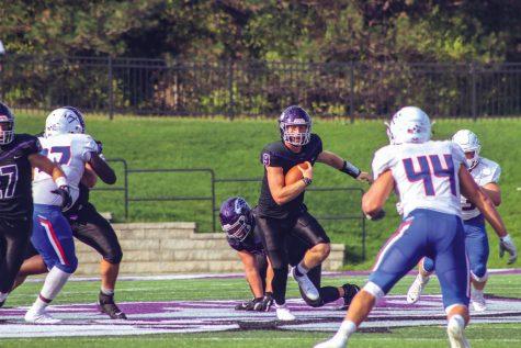 Freshman (quarterback) Jackson Chryst (9) runs across the Perkins Stadium field to score during the game against University of Wisconsin Platteville, Saturday, Oct. 9, 2021.