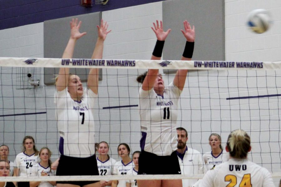 Senior middle hitter Morgan Wardall (7) and outside hitter Emma Aske (11) attempt to block a kill from UW-Oshkosh during their home game in the Williams Center on Sept. 15, 2021.