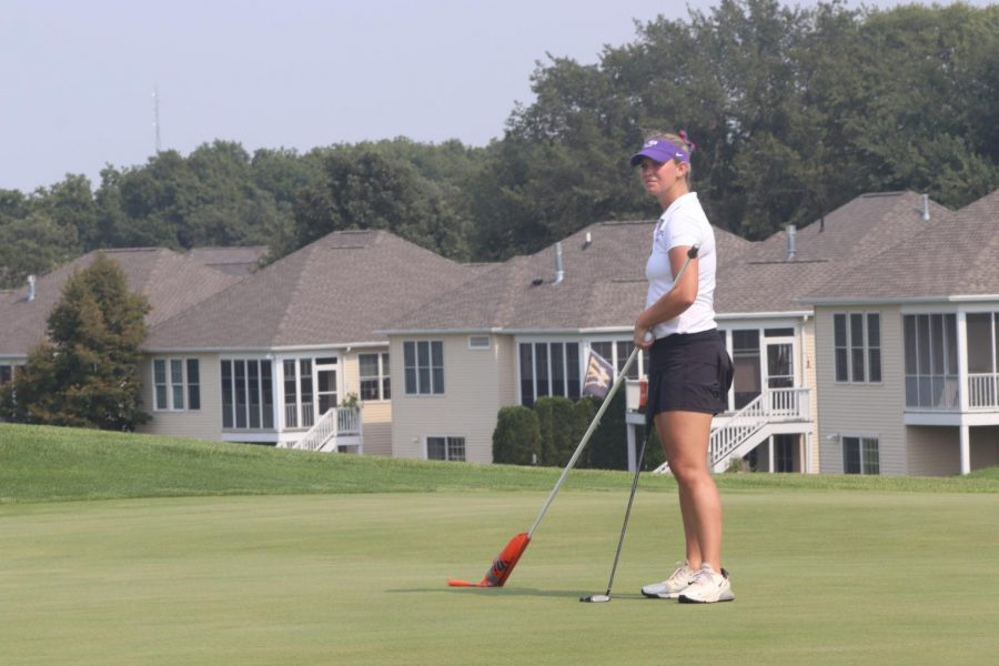 Junior Madison ( Madi) Lapaz stands awaiting their turn, Madison scoring a total of 240 points in the WIAC Championships at Reedsburg Country Club, Fall 2021.