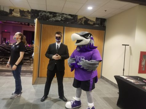 """Willie the Warhalk poses next to security Guard Justin Wesolek, who is there to """"look for all forms of life forms be it living, dead, zombies or aliens not of this world."""""""