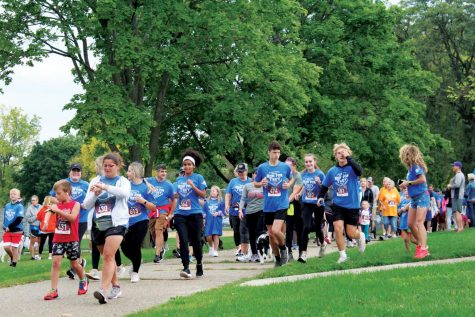 Runners take off at Treyton's Field of Dreams to begin the 11th Annual Run for Trey in Whitewater, Wisconsin Oct. 10, 2021.
